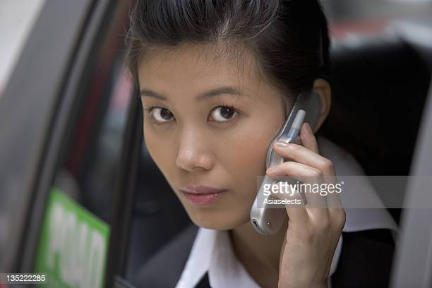 Woman looking out of taxi cab