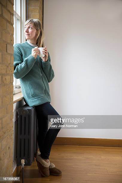 woman looking out of window over shoulder
