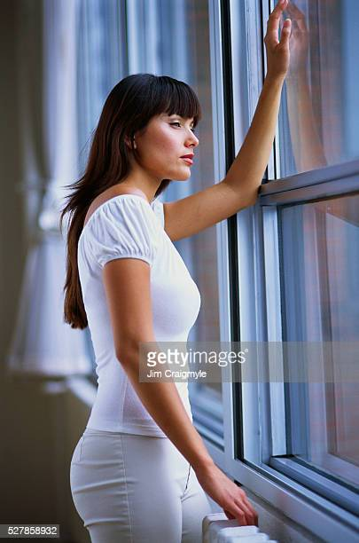 woman looking out of window - jim craigmyle stock pictures, royalty-free photos & images
