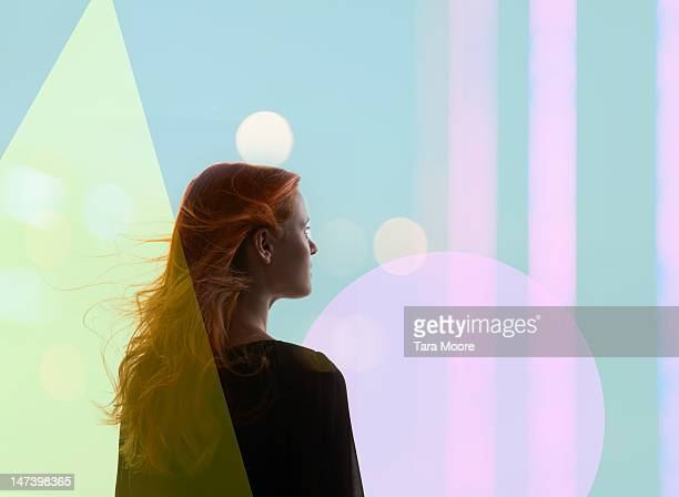 woman looking out to futuristic shapes