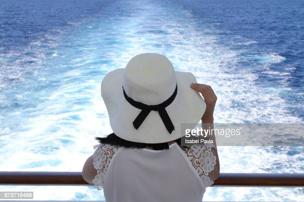 woman looking out to sea on a cruise ship - passagier wasserfahrzeug stock-fotos und bilder