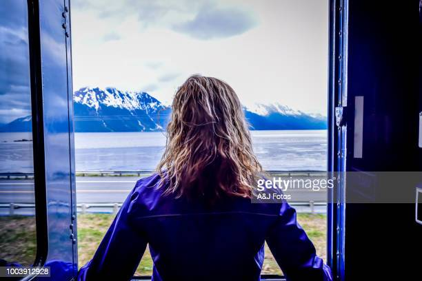 Woman looking outside a train