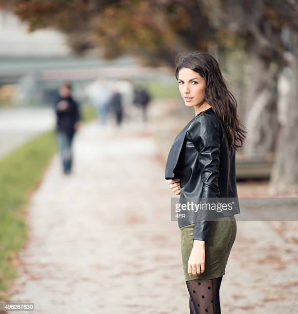 woman looking over her shoulder - dress over pants stock pictures, royalty-free photos & images