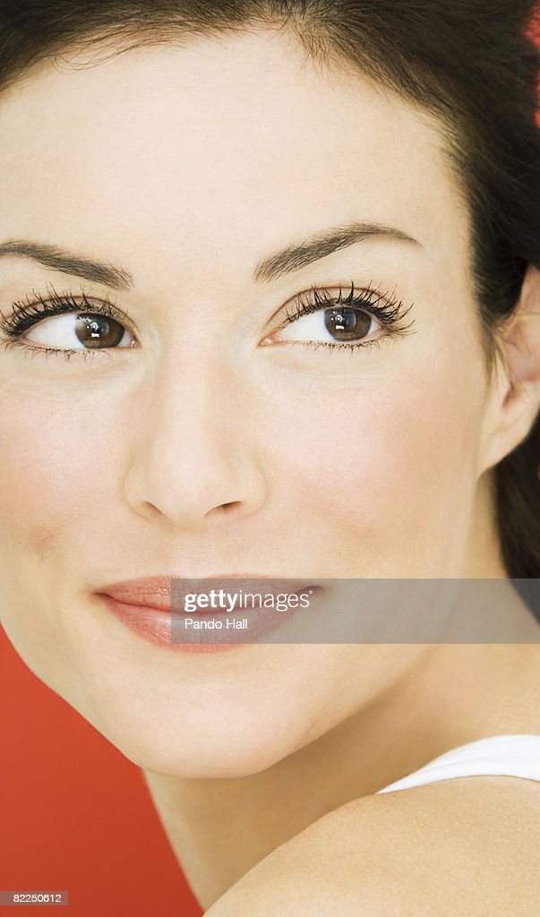Woman looking over shoulder, close-up, portrait : Stock Photo