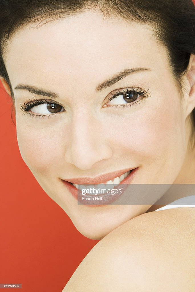Woman looking over shoulder : Stock Photo