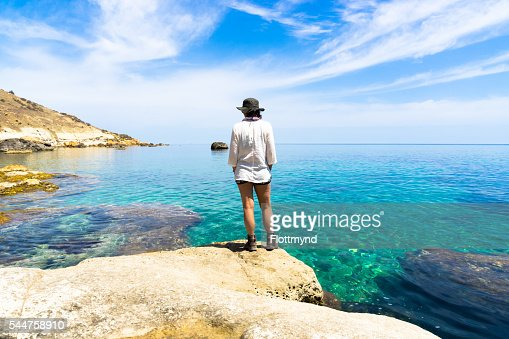 Woman looking over the Mediterranean sea