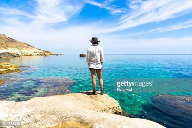 Woman looking over the Mediterranean sea