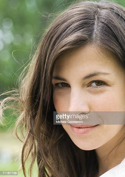 Woman looking sideways at camera, portrait