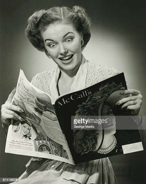 woman looking surprised, reading fashion magazine (b&w), (close-up) - picture magazine stock pictures, royalty-free photos & images
