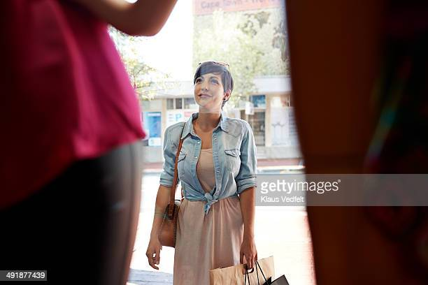 Woman looking threw shop window of fashion store
