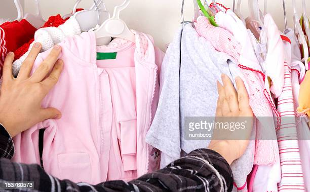 Woman looking through a closet