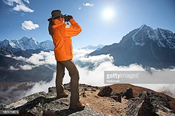 Woman looking through binoculars at Taboche in Sagarmatha National Park