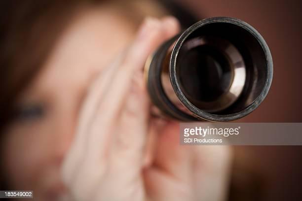 Woman Looking Through Handheld Telescope