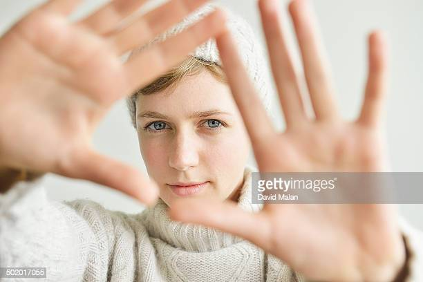 Woman looking through her hands