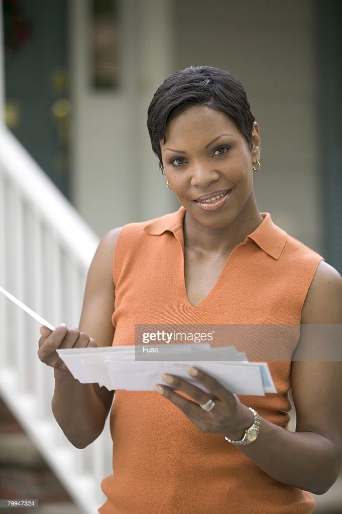 Woman Looking Through Her Mail : Stock Photo