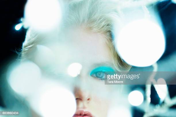 woman looking through lights