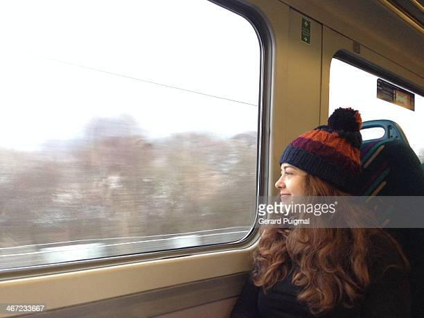 Woman looking through the window of a train