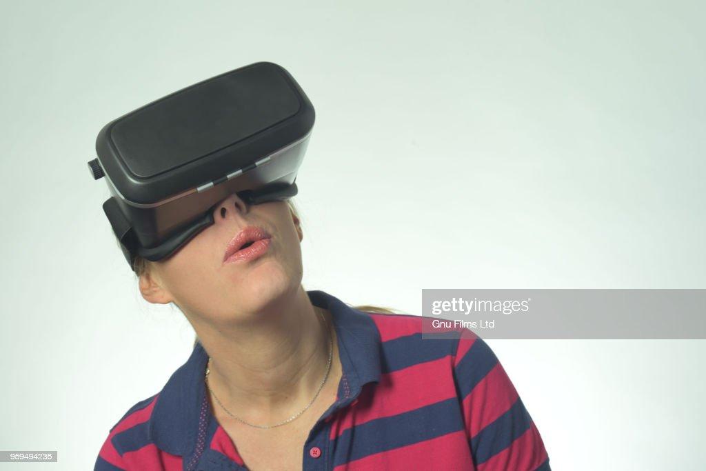 Woman Looking through Virtual Reality Goggles : Stock-Foto