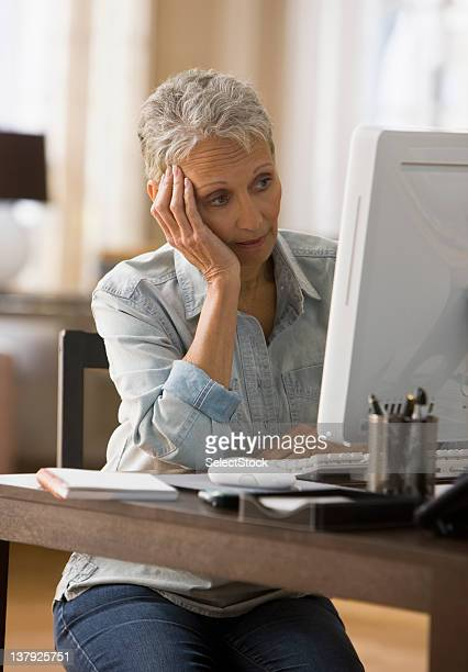 Woman looking tired in front of her computer