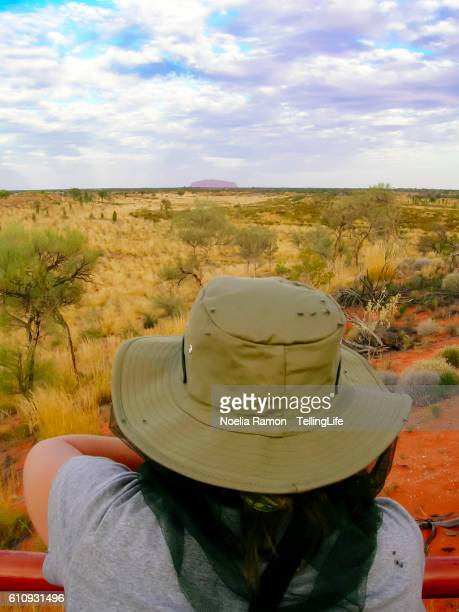 A woman looking to the endless horizon in the Australian desert