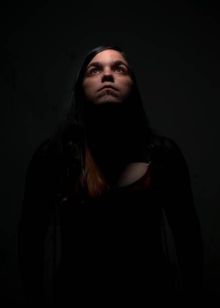 Woman looking up against black background,Navarra,Spain