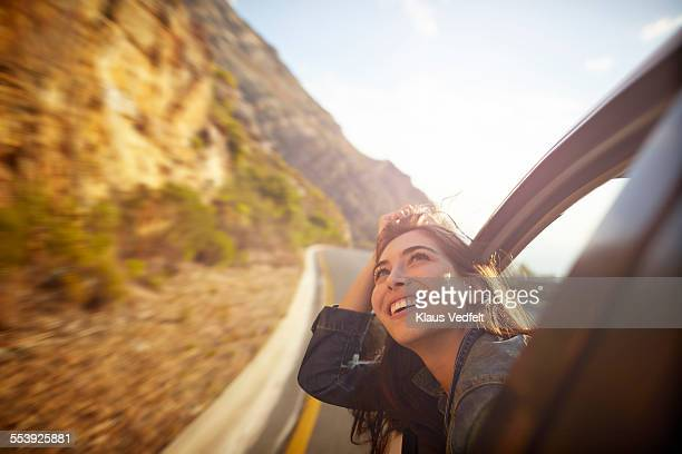 Woman looking up and out of car window