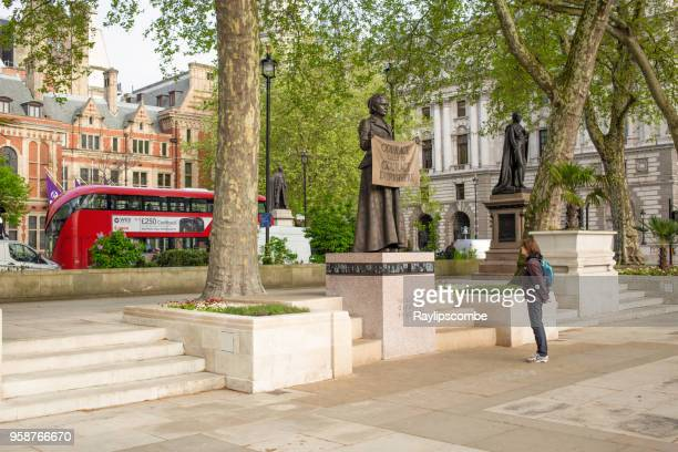 woman looking up at the newly erected statue of millicent fawcett in parliament square, london, uk, - suffragist stock photos and pictures