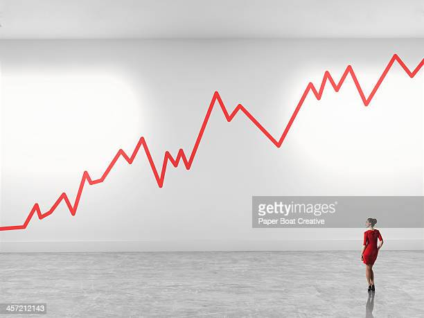 woman looking up at zig zag line in gallery - fund fair stock photos and pictures