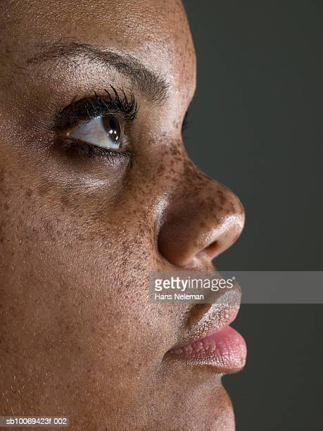 woman looking up, close-up, side view - images stock photos and pictures