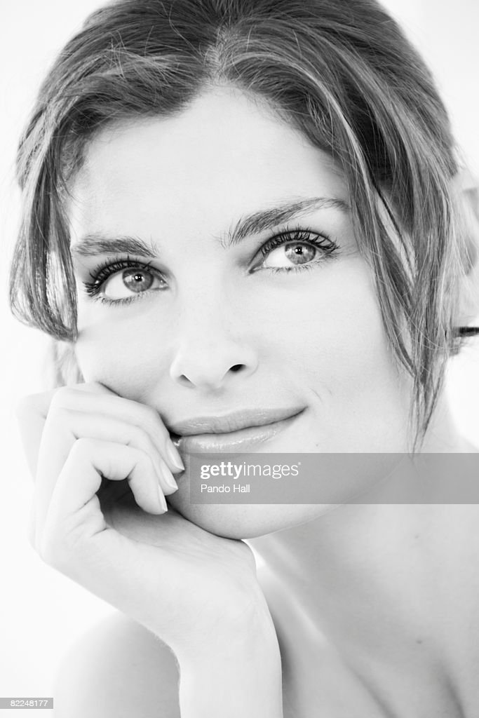 Woman looking up, head on hand, portrait : Stock Photo