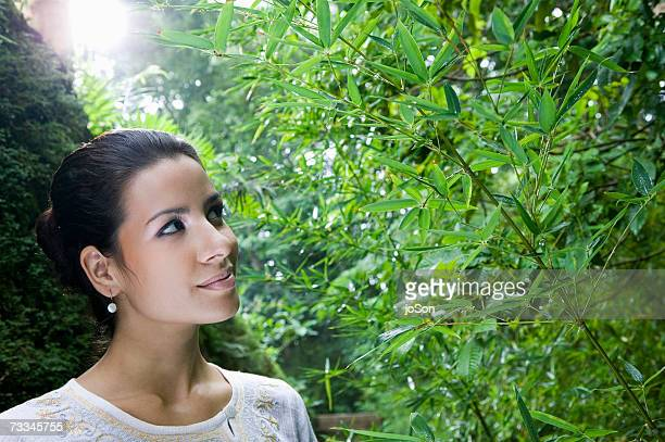 Woman looking up in rainforest