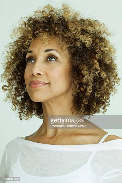 Woman looking up optimistically, portrait