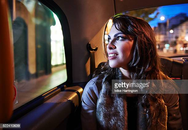 Woman looking up out of taxi window.