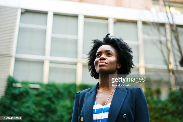 woman looking up - one young woman only stock pictures, royalty-free photos & images