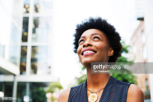 woman looking up - hope stock pictures, royalty-free photos & images