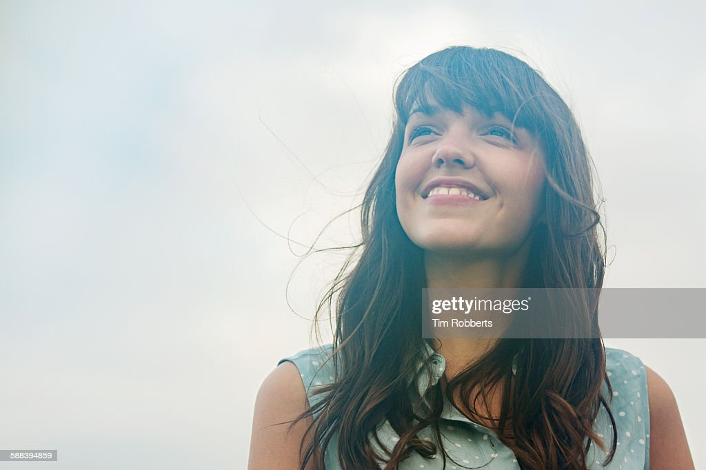 Woman looking up, smiling. : Stockfoto