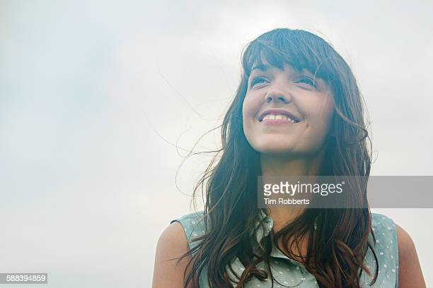 woman looking up, smiling. - contemplation stock pictures, royalty-free photos & images