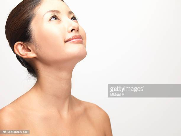woman looking up, studio shot - beautiful bare breasted women stock pictures, royalty-free photos & images