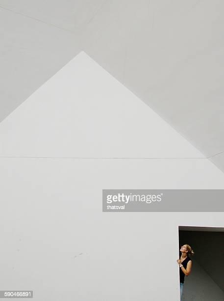 Woman looking up through a door