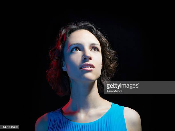 woman looking up with black background - black background stock pictures, royalty-free photos & images