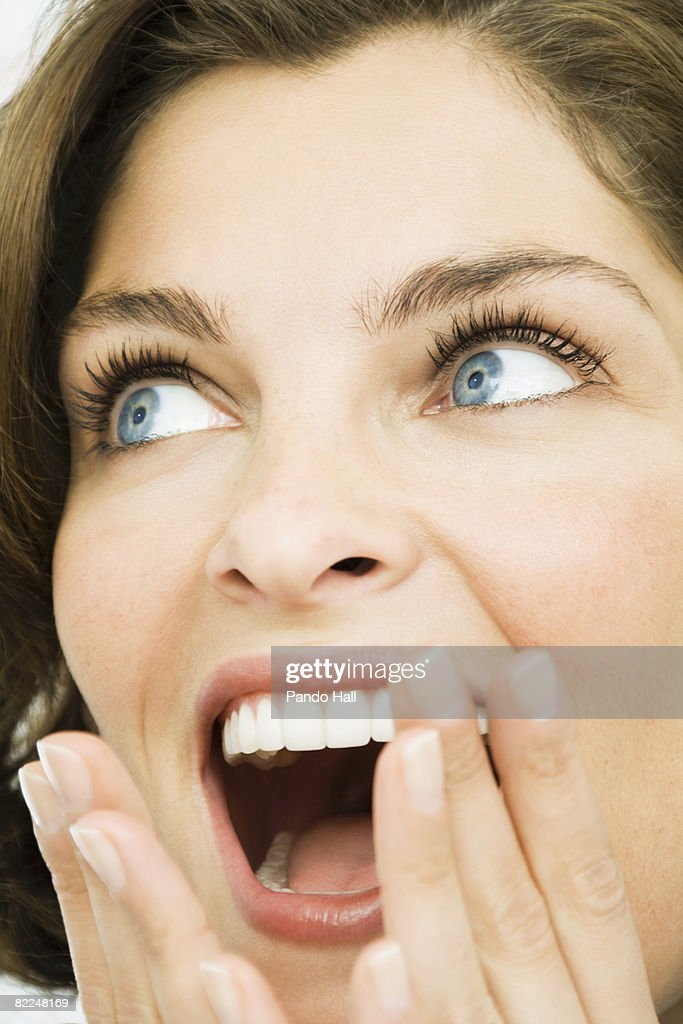Woman looking up, yelling : Stock Photo