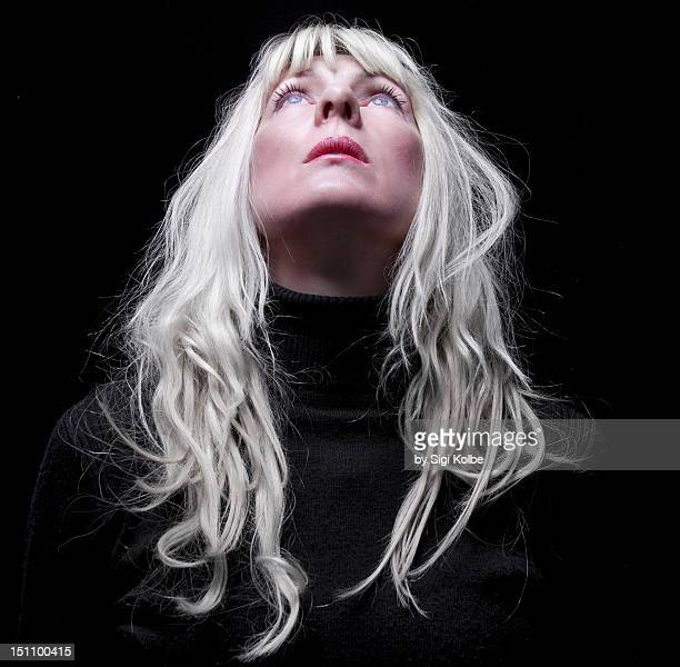 woman looking upward into light - head back stock pictures, royalty-free photos & images