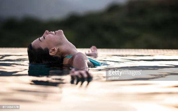 Woman looking very relaxed in the swimming pool