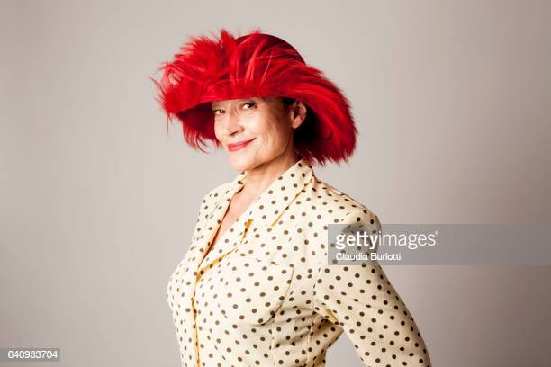 woman looking young - red hat stock pictures, royalty-free photos & images