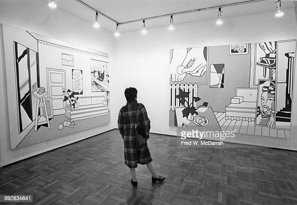 A woman looks a pair of paintings in Roy Lichtenstein's exhibition at the Leo Castelli Gallery New York New York November 7 1974