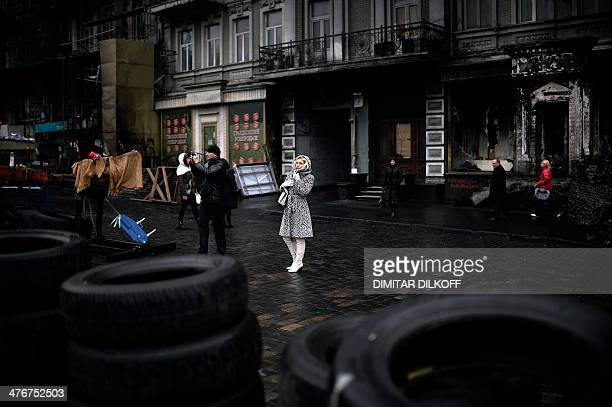 A woman looks at a barricade near the Dinamo stadium close to Independence Square in Kiev on March 5 2014 The Ukrainian army was put on alert over...