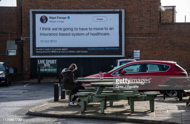 A woman looks at a billboard with a quote from former UKIP party leader Nigel Farage on March 11 2019 in London United Kingdom The billboard campaign...