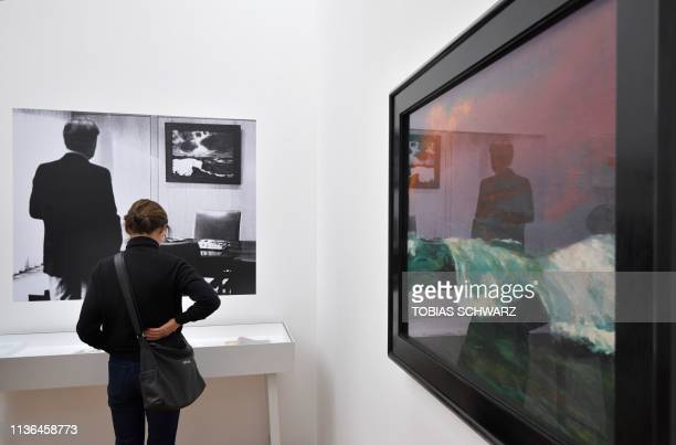 """Woman looks at a cabinet near the painting """"Brecher"""" at the exhibition of German painter Emil Nolde at the Hamburger Bahnhof museum in Berlin on..."""