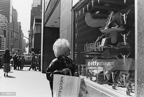A woman looks at a California themed window display at Bloomingdale's department store New York City USA 11th April 1989