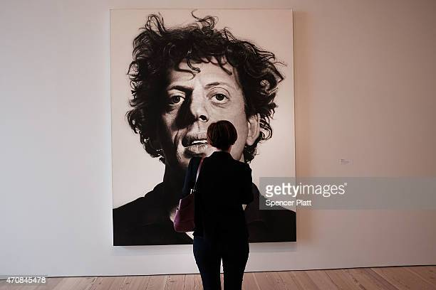 A woman looks at a Chuck Close painting in a gallery at the relocated Whitney Museum of American Art in Manhattan's meatpacking district on April 23...